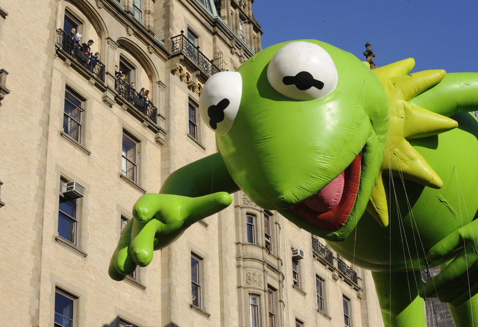 Photo -   The Kermit The Frog balloon makes its way down New York's Central Park West in celebration of the 86th annual Macy's Thanksgiving Day Parade,Thursday, Nov 22, 2012. (AP Photo/ Louis Lanzano)