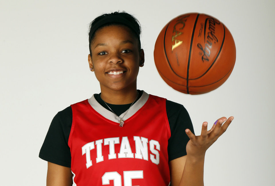 Photo - Gioya Carter, Carl Albert High School basketball player and member of the Girls Super 5 and Big All-City team, poses for a photo at the OPUBCO studio in Oklahoma City, Wednesday, April 10, 2013. Photo by Nate Billings, The Oklahoman