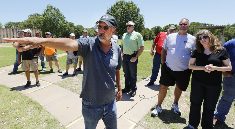 Photo - Mike McAllister, with the Oklahoma Wildlife Department gives instructions to teachers in the Scholastic Shooting Program at the OKC Gun Club in Oklahoma City, Thursday June 11, 2013. Photo By Steve Gooch, The Oklahoman