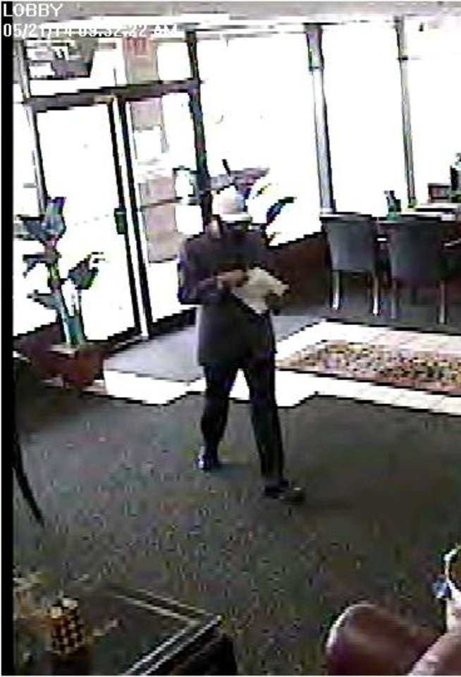 A man who revealed a pistol tucked in his waistband robbed the First Fidelity Bank, 10904 N May Ave. in northwest Oklahoma City, about 9:45 a.m. Wednesday. <cutline_credit_leadin>Photo provided</cutline_credit_leadin> <strong></strong>