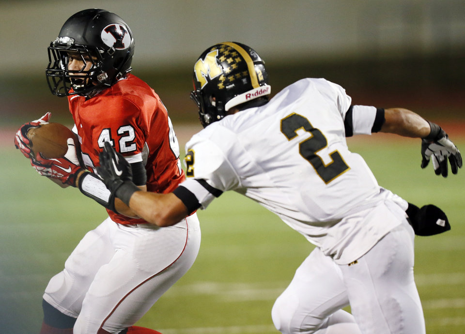 Photo -                    Caleb Davis, left, is one of Yukon's three experienced running backs.                                        Photo by Nate Billings, The Oklahoman Archives