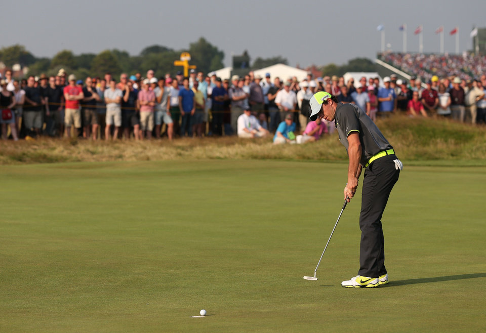 Photo - Rory McIlroy of Northern Ireland putts a birdie on the 17th green during the second day of the British Open Golf championship at the Royal Liverpool golf club, Hoylake, England, Friday July 18, 2014. (AP Photo/Scott Heppell)