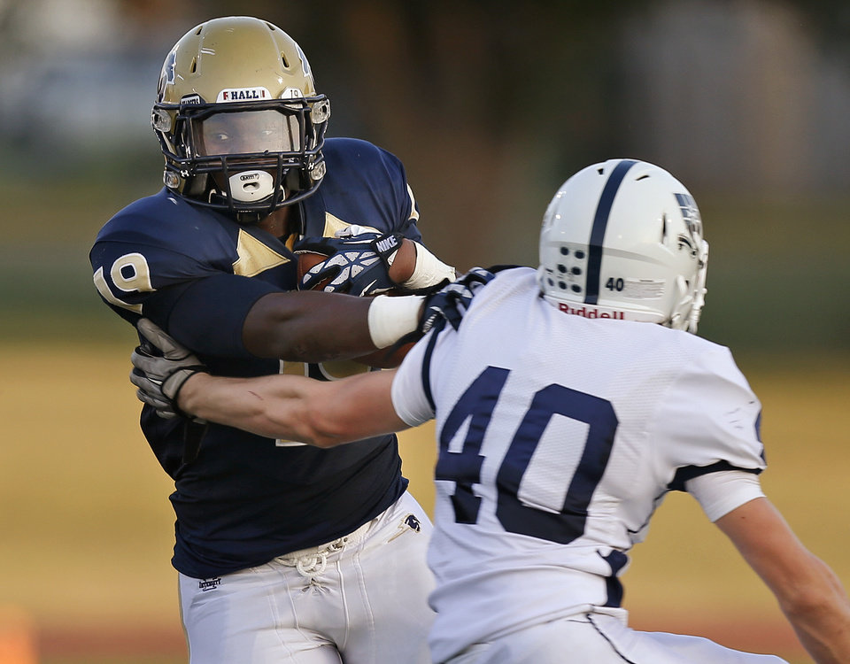 Photo - Heritage Hall's Terrell Love goes past Casady's James Bennett during their high school football game at Heritage Hall in Oklahoma City, Thursday, September 5, 2013. Photo by Bryan Terry, The Oklahoman