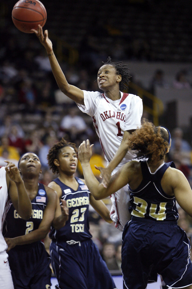 Photo - Nyeshia Stevenson is charged with an offensive foul against Iasia Hemingway (34) in the second half as the University of Oklahoma (OU) plays Georgia Tech in round two of the 2009 NCAA Division I Women's Basketball Tournament at Carver-Hawkeye Arena at the University of Iowa in Iowa City, IA on Tuesday, March 24, 2009. 