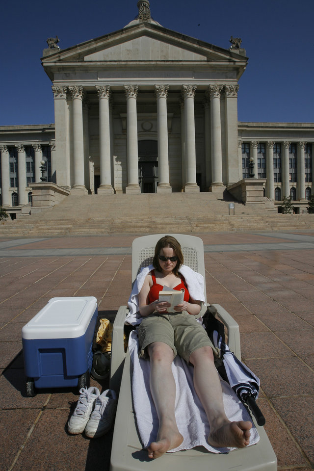 Photo - PROTESTER, SUNBATHE, SUNBATHING: Susan Mills, 23, is spending her spring break from OCCC sitting outside the Capitol to protest legislators taking gifts from lobbyists, Wednesday, March 19, 2008. Photo by DAVID MCDANIEL, THE OKLAHOMAN.    ORG XMIT: KOD