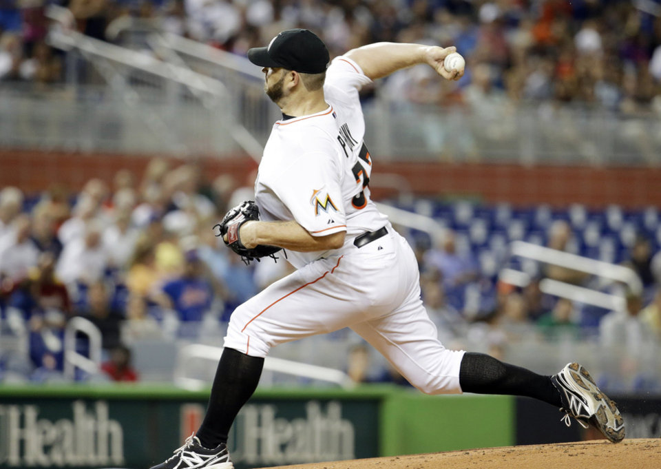 Photo - Miami Marlins starting pitcher Brad Penny throws in the first inning during a baseball game against the New York Mets, Tuesday, Sept. 2, 2014, in Miami. (AP Photo/Lynne Sladky)