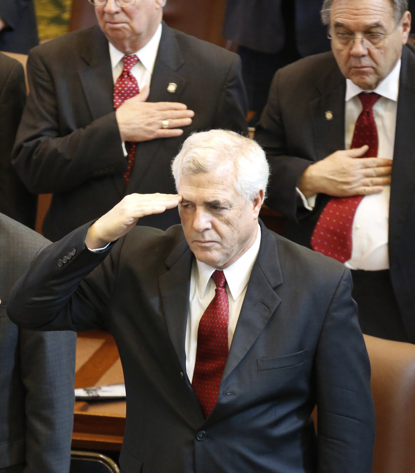 Photo - State Rep. Mike Reynolds, R-Oklahoma City, salutes the flag before Governor Mary Fallin's  State of the State address at the state Capitol in Oklahoma City, Monday February  04, 2013. Photo By Steve Gooch, The Oklahoman