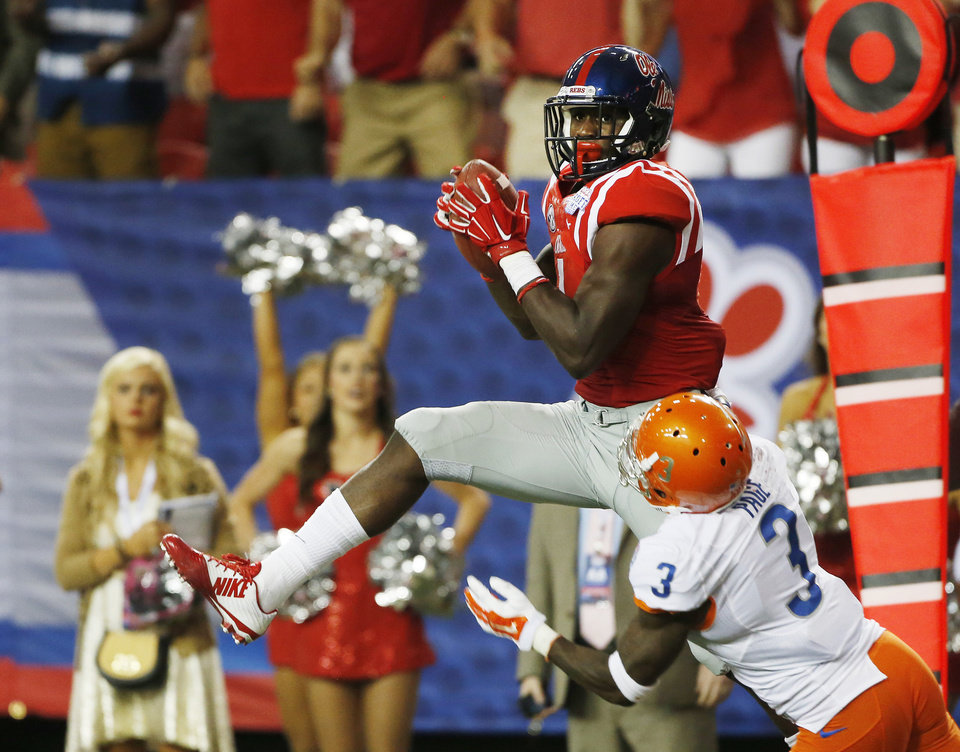 Photo - Mississippi wide receiver Laquon Treadwell (1) makes a catch for a touch down as Boise State cornerback Cleshawn Page (3) defends in the second half of an NCAA college football game, Thursday, Aug. 28, 2014, in Atlanta.  (AP Photo/John Bazemore)