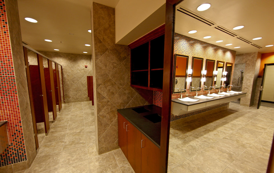 Photo - OSU / INTERIOR / FOOTBALL STADIUM / RESTROOM: The completed addition to the west end zone of Boone Pickens Stadium at Oklahoma State University on Tuesday, June 2, 2009, in Stillwater, Okla.  Photo by Chris Landsberger, The Oklahoman  ORG XMIT: KOD