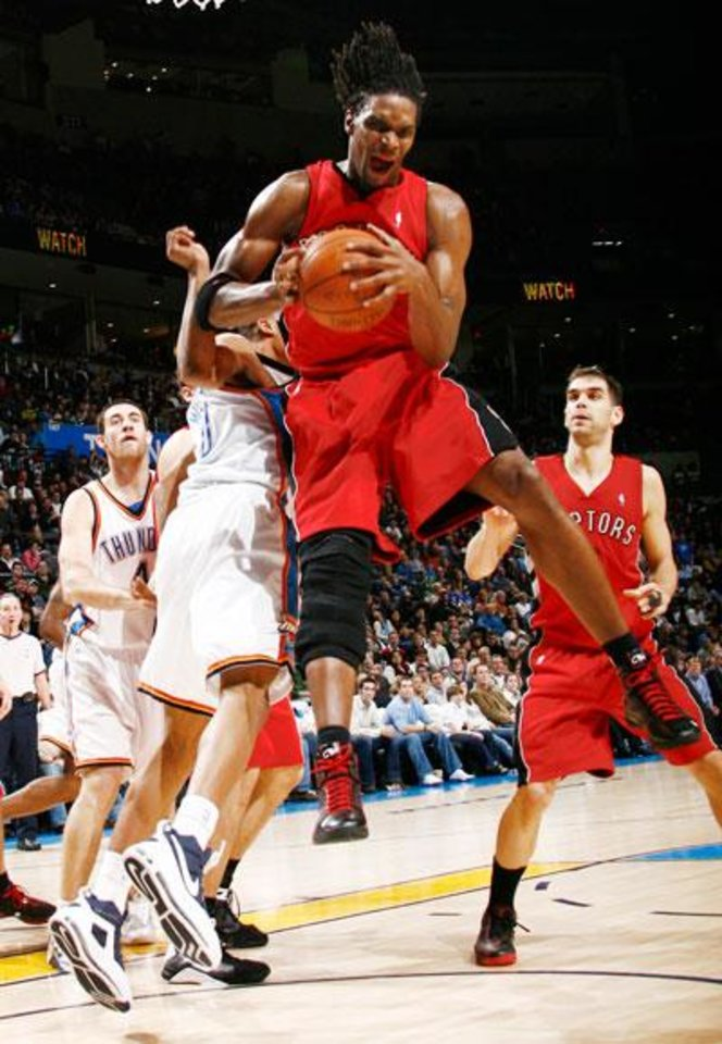 Photo -  Toronto's Chris Bosh grabs a rebound in the second half of the NBA basketball game between the Toronto Raptors and the Oklahoma City Thunder at the Ford Center in Oklahoma City, Friday, Dec. 19, 2008. The Thunder won, 91-83. BY NATE BILLINGS, THE OKLAHOMAN