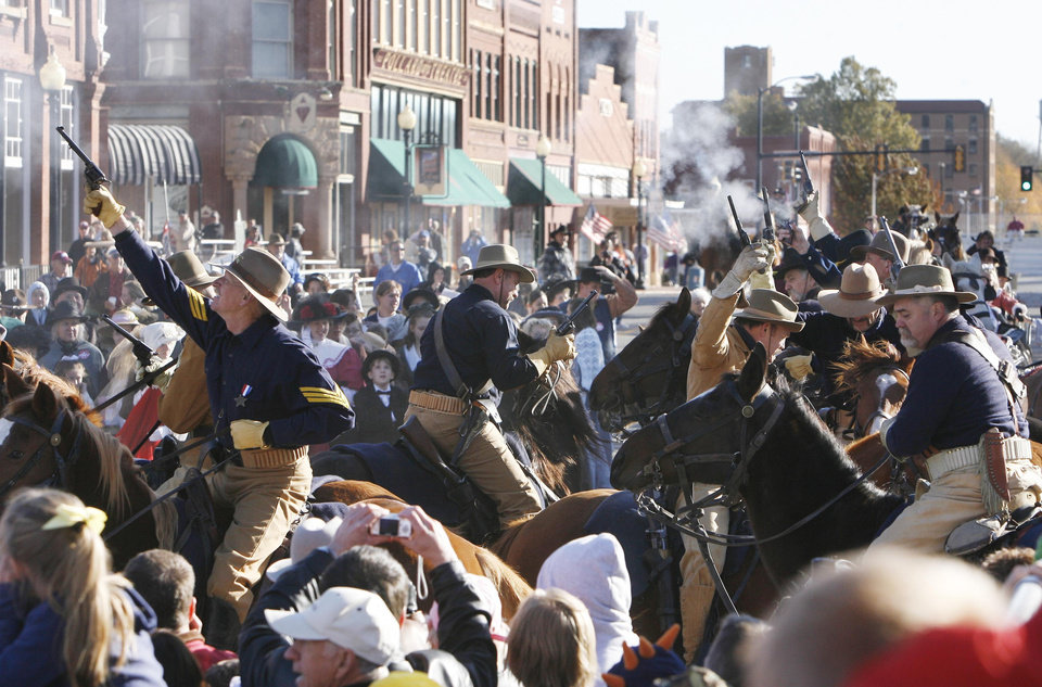 Photo - The Oklahoma Cavalry starts a volley of pistol shots after the announcement of statehood, during the Centennial Day celebrations in Guthrie, OK, Thursday, Nov. 16, 2007. By Paul Hellstern / The Oklahoman