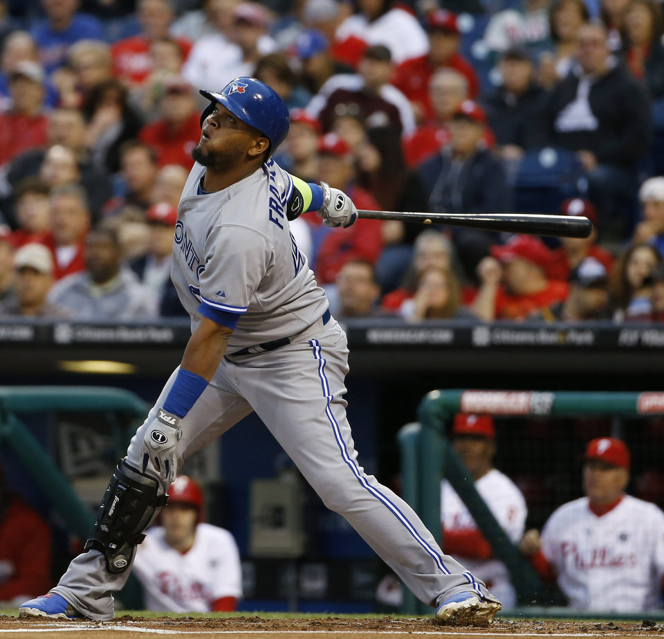 Photo - Toronto Blue Jays' Juan Francisco follows through after hitting a run-scoring single during the first inning of an interleague baseball game against the Philadelphia Phillies, Monday, May 5, 2014, in Philadelphia. (AP Photo/Matt Slocum)