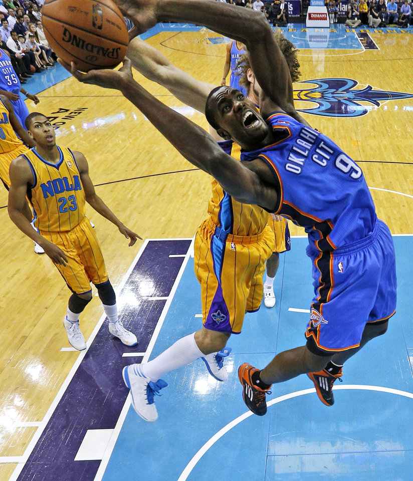 Photo - Oklahoma City Thunder power forward Serge Ibaka (9) goes to the basket during the first half of an NBA basketball game against the New Orleans Hornets in New Orleans, Friday, Nov. 16, 2012. The Thunder won 110-95. (AP Photo/Jonathan Bachman) ORG XMIT: LAJB117