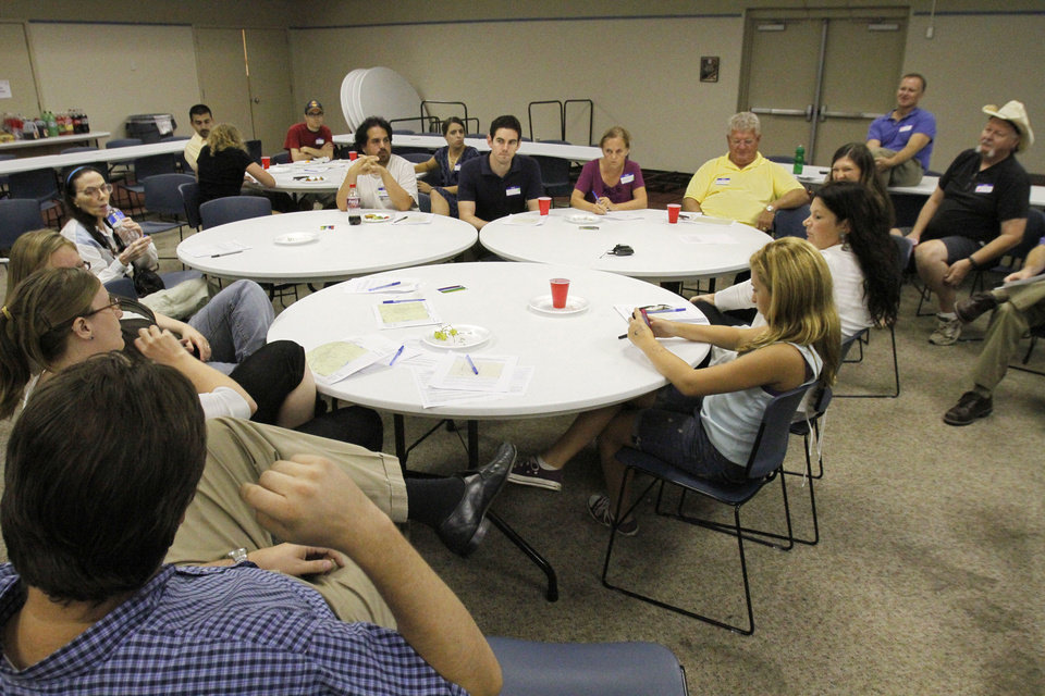 Photo - The first Tornado Town Hall meeting was held Thursday at the Norman Public Library as those in the weather-safety field asked residents of Norman and surrounding areas what they've heard and what they know about tornadoes.  Photo by David McDaniel, The Oklahoman