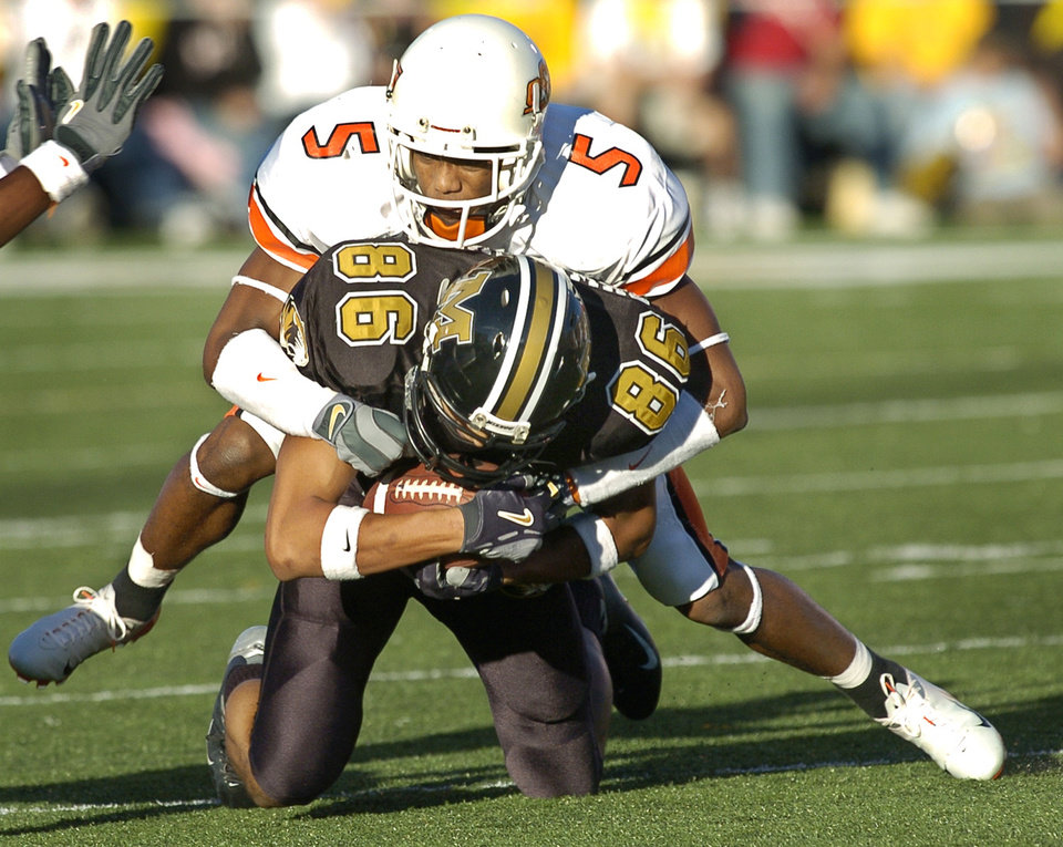 Photo - Ricky Coxeff, who played at OSU in 2003 and 2004 told Sports Illustrated he waited in cars while Darrent Williams and Tatum Bell received cash from Joe DeForest. OKLAHOMAN ARCHIVE PHOTO