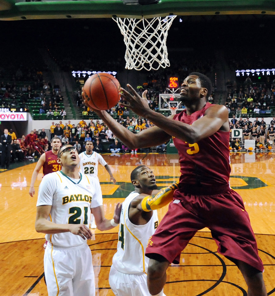 Iowa State's Georges Niang (31) shoots past Baylor's Cory Jefferson (34) and Isaiah Austin (21) in the first half of an NCAA college basketball game, Wednesday, Feb. 20, 2013, in Waco, Texas. (AP Photo/The Waco Tribune-Herald, Rod Aydelotte)