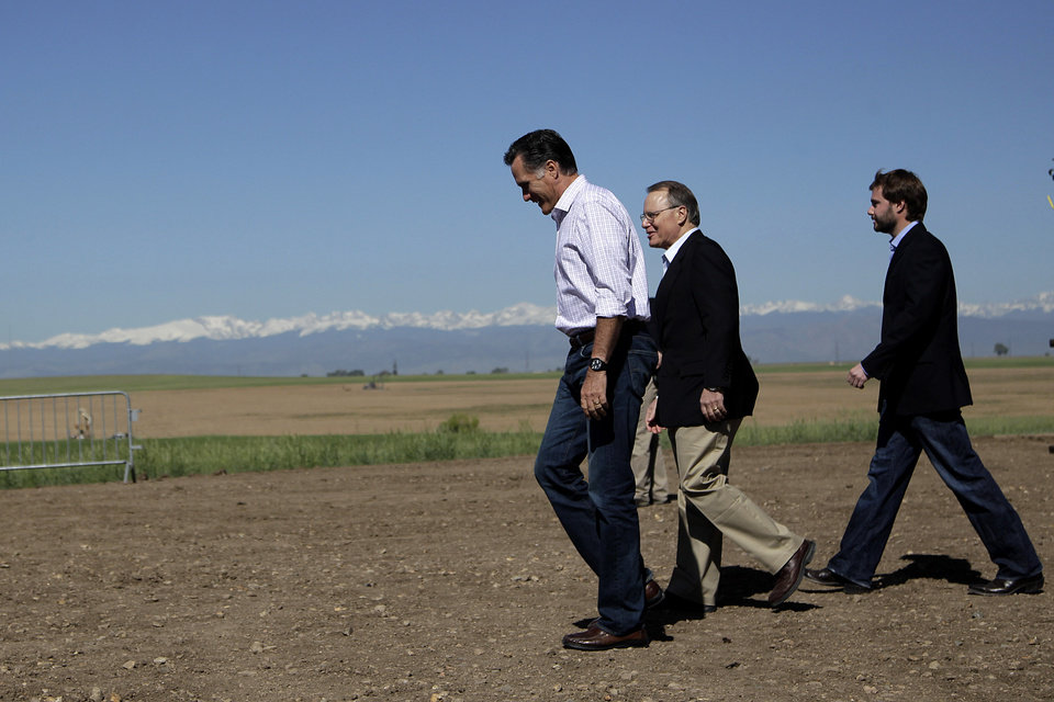 Photo -   Republican presidential candidate, former Massachusetts Gov. Mitt Romney, center, walks with Kevin Kauffman, CEO and president of KP Kauffman Co., an oil and gas production and drilling company, at a campaign stop in Fort Lupton, Colo.,Wednesday, May 9, 2012. (AP Photo/Jae C. Hong)