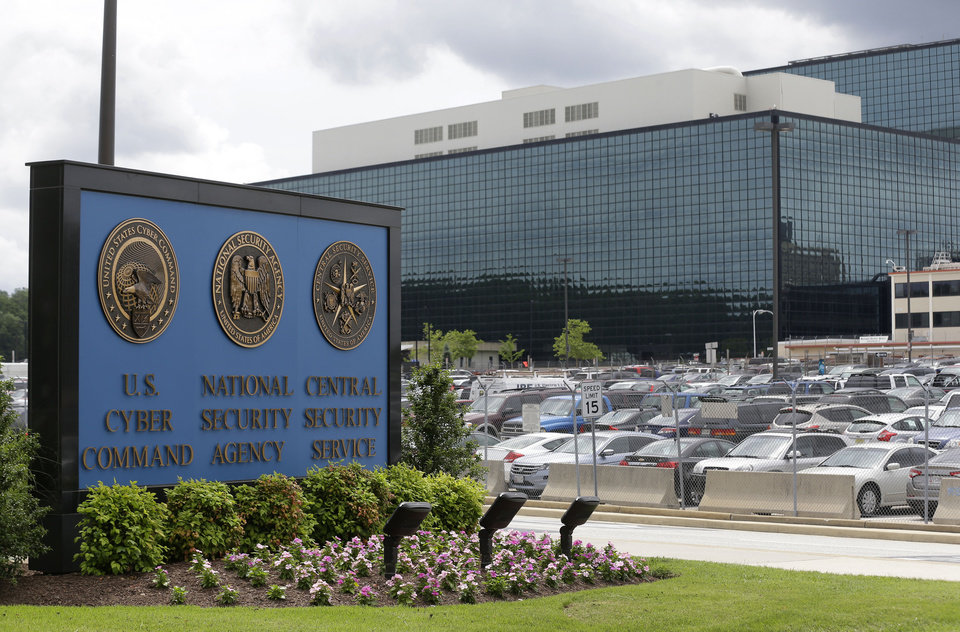 Photo - FILE - This June 6, 2013 file photo shows a sign outside the National Security Agency (NSA) campus in Fort Meade, Md. The latest study of the the bipartisan Privacy and Civil Liberties Oversight Board takes the opposite view of a different set of National Security Agency surveillance programs revealed last year by former NSA systems administrator Edward Snowden. The board which was to vote on the report on Wednesday, July 2, 2014, found that the NSA's collection of Internet data within the United States passes constitutional muster and employs