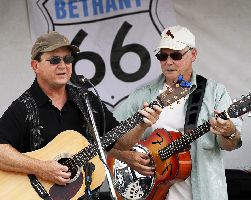 Mark McDaniel, left and Mike  Garey, members of Lost River, a local band, provide musical entertainment   at the Bethany 66 Festival in a parking lot in the city's downtown area Saturday,  May 26,  2012,  Photo by Jim Beckel, The Oklahoman