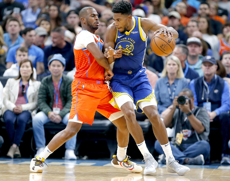 Photo - Oklahoma City's Chris Paul (3) defends against Golden State's Glenn Robinson III (22) during the NBA game between the Oklahoma City Thunder and Golden State Warriors at Chesapeake Energy Arena,  Sunday, Oct. 27, 2019. [Sarah Phipps/The Oklahoman]
