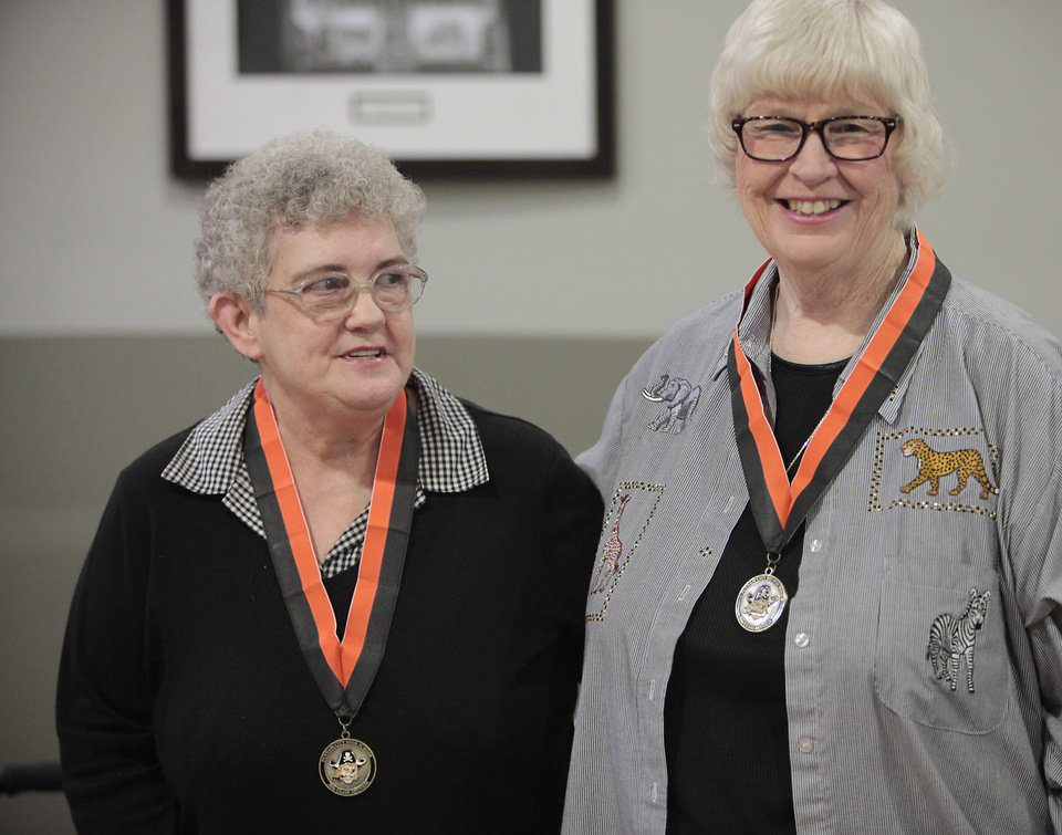 Photo - Putnam City High School class of 1963 members Carola Smith and Candy Keyser wear their 50 year medals while talking about their experience in participating in Project Talent, Thursday, October 31, 2013. Photo by David McDaniel, The Oklahoman