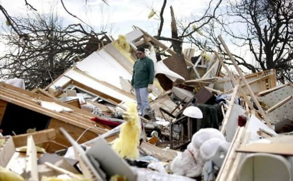 Jimmy Wyatt, stands on tornado damage at a friend's home who died in the storm in Lone Grove, Okla, Thursday, Feb, 12, 2009. PHOTO BY SARAH PHIPPS, THE OKLAHOMAN