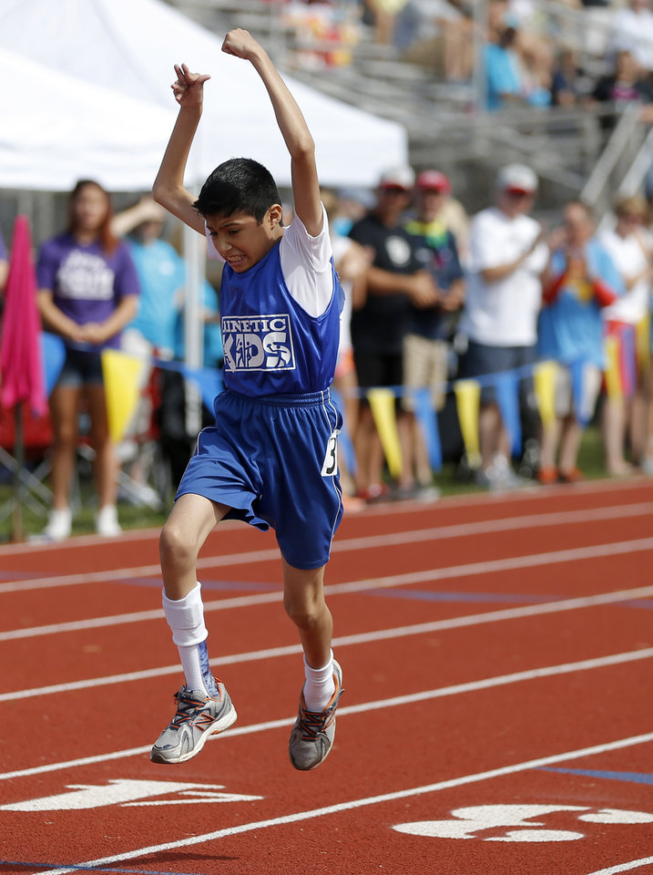 Arturo Liendo reacts as he crosses the finish line during a race in the UCO Endeavor Games at the Edmond North High School School track, Saturday, June 7, 2014. Photo by Bryan Terry, The Oklahoman