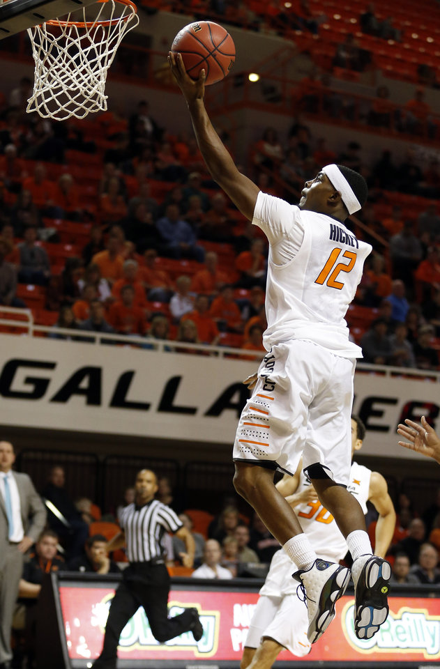Photo - Oklahoma State's Anthony Hickey Jr. (12) goes up for a lay up during the men's college between Oklahoma State University and Missouri Western at Gallagher-Iba Arena in Stillwater, Okla., Saturday, Nov. 8, 2014.  Photo by Sarah Phipps, The Oklahoman