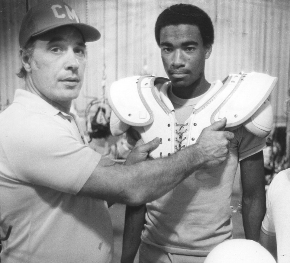 Photo - Don Bucci, left, played at Notre Dame and coached at Cardinal Mooney High School.  PHOTO COURTESY YOUNGSTOWN VINDICATOR