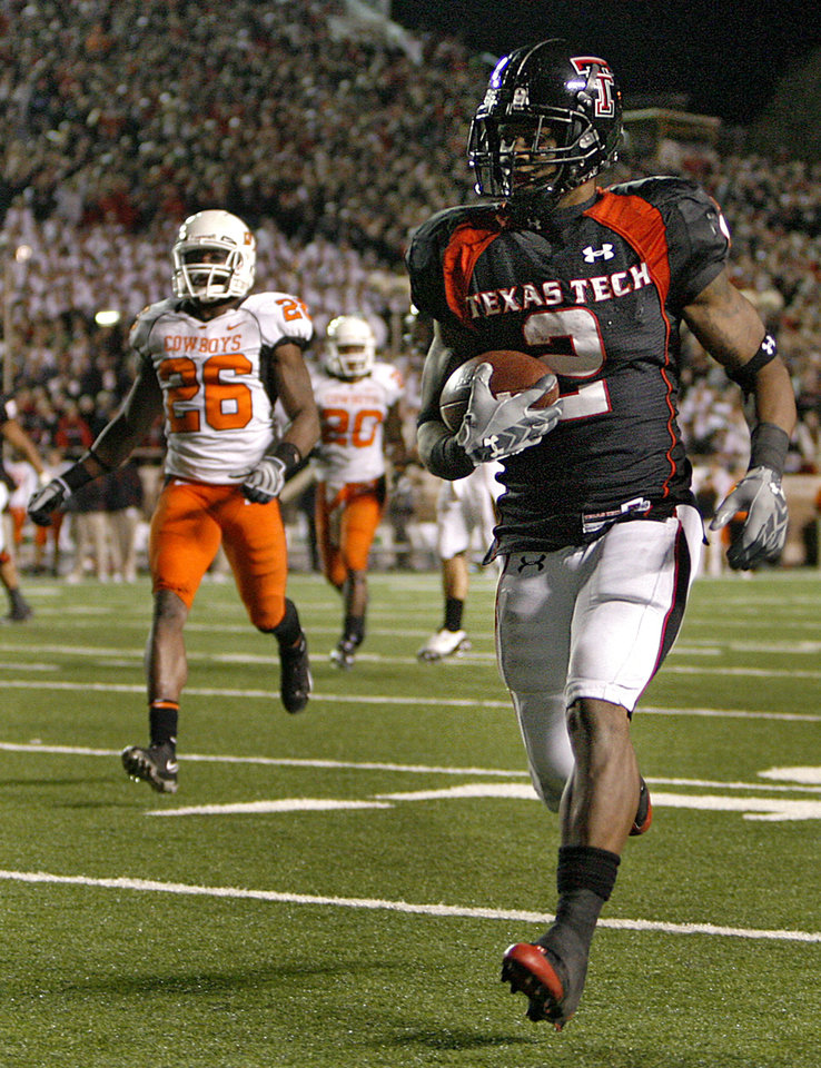 Photo - Texas Tech's Shannon Woods (2) out runs Oklahoma State's Quinton Moore (26) for a touchdown during the second half of the college football game between the Oklahoma State University Cowboys (OSU) and the Texas Tech Red Raiders at Jones AT&T Stadium on Saturday, Nov. 8, 2008, in Lubbock, Tex.BY CHRIS LANDSBERGER/THE OKLAHOMAN
