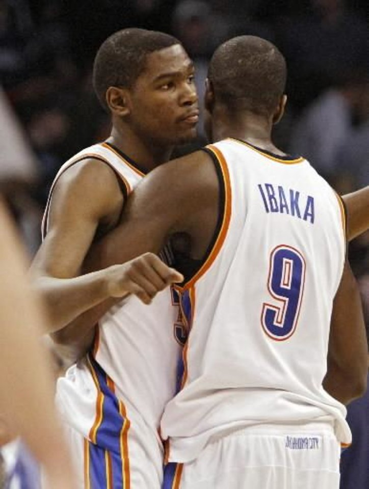 Kevin Durant hugs  Serge  Ibaka (9) after the 99-96 loss to the Spurs during the second half of the NBA basketball game between the Oklahoma City Thunder and the San Antonio Spurs at the Ford Center on Monday, March 22, 2010, in Oklahoma City, Okla. Photo by Chris Landsberger