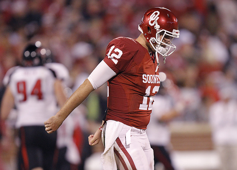 Photo - Landry Jones reacts after throwing an interception during the college football game between the University of Oklahoma Sooners (OU) and Texas Tech University Red Raiders (TTU) at the Gaylord Family-Oklahoma Memorial Stadium on Saturday, Oct. 22, 2011. in Norman, Okla. Photo by Chris Landsberger, The Oklahoman