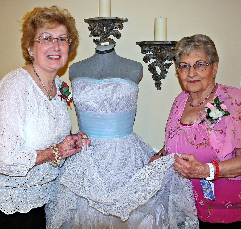 Cheyenne Middle School students served as greeters at Touchmark at Coffee Creek\'s \'senior\' prom recently. Josie Codispoti, left, and Flo Owens with a 1959 prom dress.