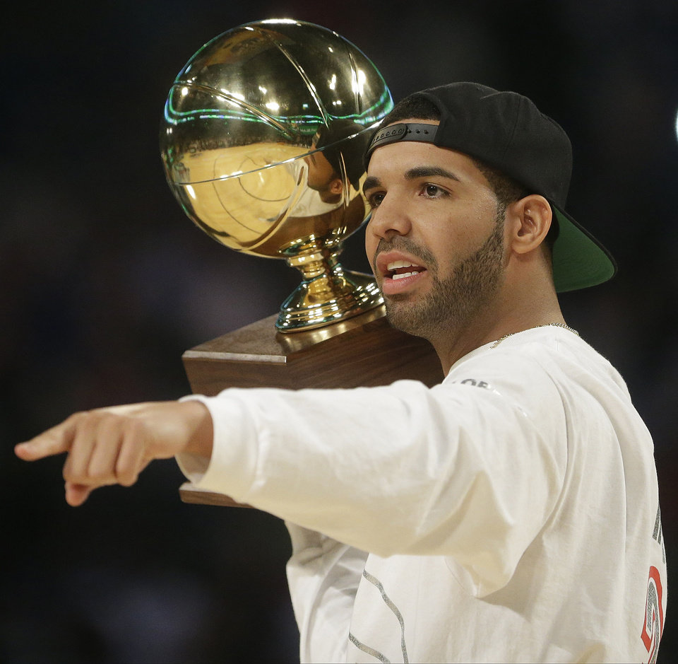 Photo - Rapper Drake walks on the court during the skills competition at the NBA All Star basketball game, Saturday, Feb. 15, 2014, in New Orleans. (AP Photo/Gerald Herbert)