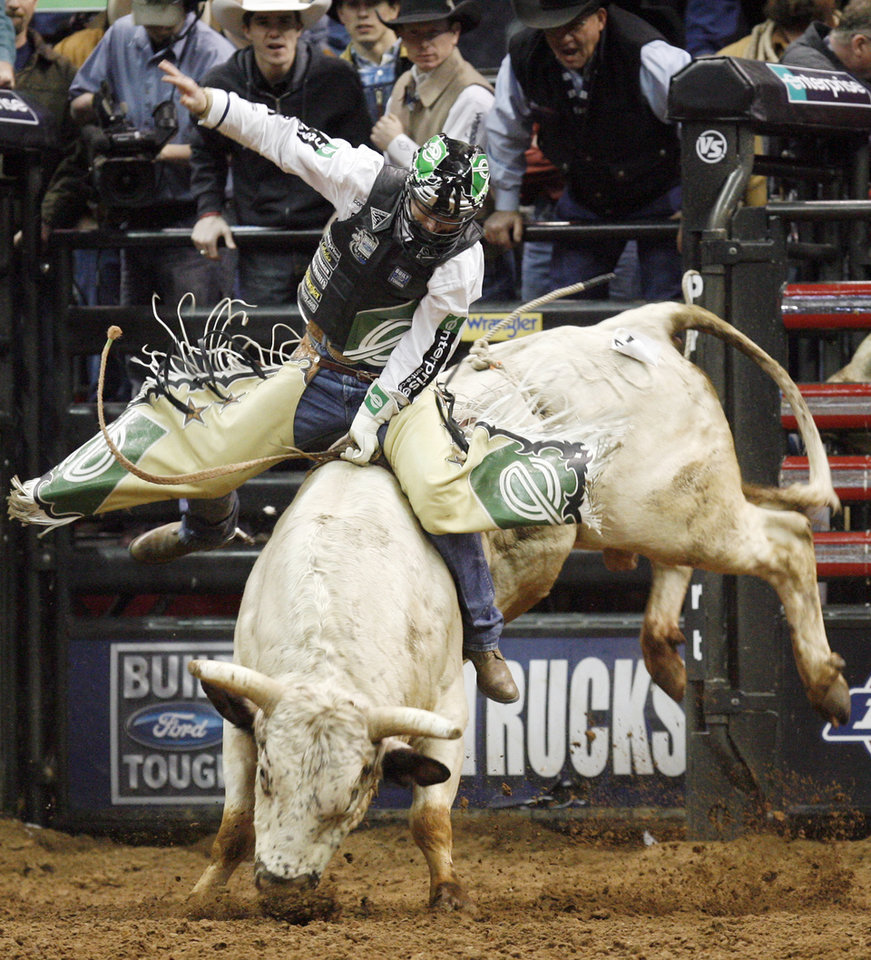 PROFESSIONAL BULL RIDERS: Cord McCoy of Tupelo, Okla., rides Rebel Chicken to a score of 83.75 during the first round of the PBR's Copenhagen Bull Riding Challenger Tour Championship at the Ford Center in Oklahoma City, February 15, 2008. BY NATE BILLINGS, THE OKLAHOMAN ORG XMIT: KOD