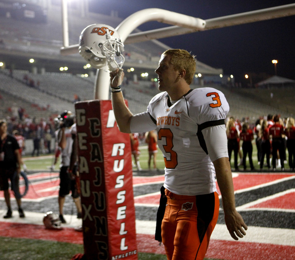 Photo - OS's Brandon Weeden waves to the crowd during the football game between the University of Louisiana-Lafayette and Oklahoma State University at Cajun Field in Lafayette, La., Friday, October 8, 2010. Photo by Bryan Terry, The Oklahoman