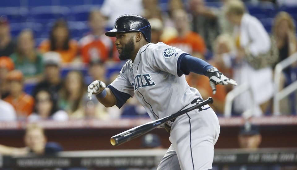 Photo - Seattle Mariners' Robinson Cano grounds out during the first inning of a baseball game against the Miami Marlins in Miami, Saturday, April 19, 2014. (AP Photo/J Pat Carter)