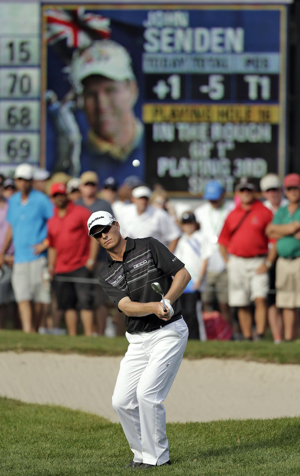 Photo - John Senden, of Australia, chips in on the 16th hole during the final round of the Valspar Championship golf tournament at Innisbrook, Sunday, March 16, 2014, in Palm Harbor, Fla. Senden went on to win the tournament. (AP Photo/Chris O'Meara)
