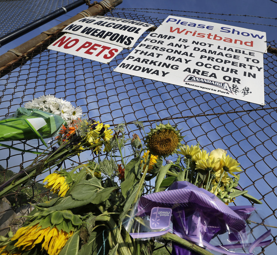 Photo - A small memorial of flowers is seen at Canandaigua Motorsports Park Monday, Aug. 11, 2014, in Canandaigua, N.Y. On Saturday night, Tony Stewart struck and killed Kevin Ward Jr., 20, a sprint car driver who had climbed from his car and was on the track trying to confront Stewart during a race at the track in upstate New York. Ontario County Sheriff Philip Povero said his department's investigation is not criminal and that Stewart was