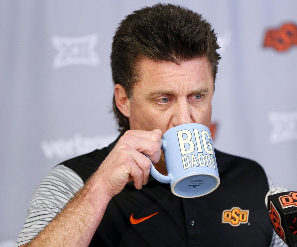 Photo - Oklahoma State coach Mike Gundy drinks from his
