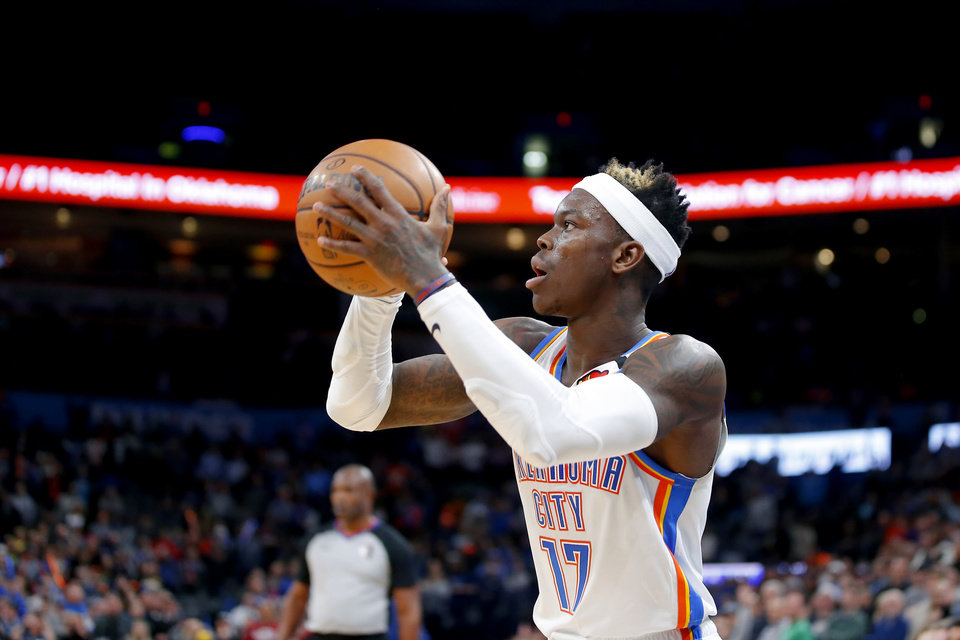 Photo - Oklahoma City's Dennis Schroder (17) makes a 3-pointer during an NBA basketball game between the Oklahoma City Thunder and the Cleveland Cavaliers at Chesapeake Energy Arena in Oklahoma City, Wednesday, Feb. 5, 2020. Oklahoma City won 109-103. [Bryan Terry/The Oklahoman]