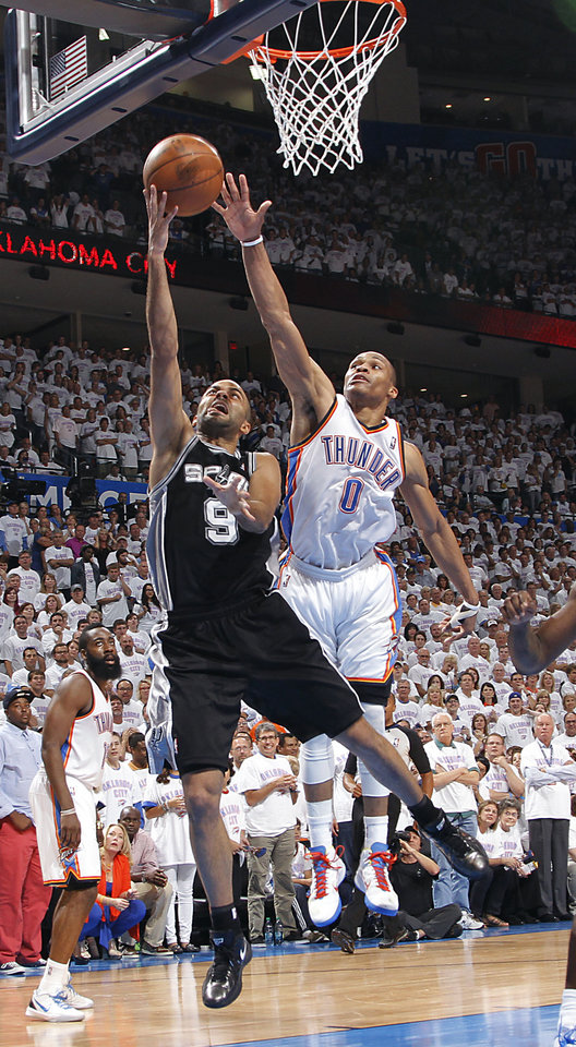 Oklahoma City\'s Russell Westbrook (0) defends on San Antonio\'s Tony Parker (9) during Game 6 of the Western Conference Finals between the Oklahoma City Thunder and the San Antonio Spurs in the NBA playoffs at the Chesapeake Energy Arena in Oklahoma City, Wednesday, June 6, 2012. Photo by Chris Landsberger, The Oklahoman