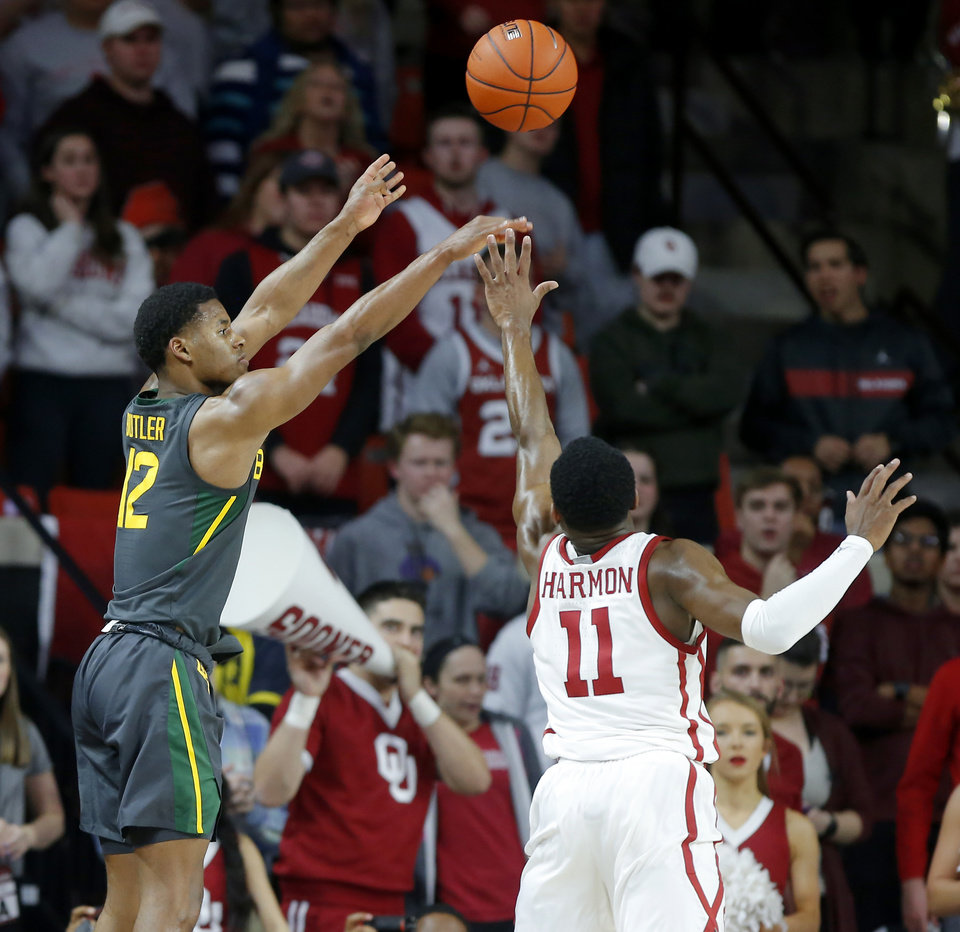 Photo - Baylor's Jared Butler (12) shoots basket over Oklahoma's De'Vion Harmon (11) during a men's NCAA basketball game between the University of Oklahoma Sooners (OU) and the Baylor Bears at the Lloyd Noble Center in Norman, Okla., Tuesday, Feb. 18, 2020. Baylor won 65-54. [Bryan Terry/The Oklahoman]