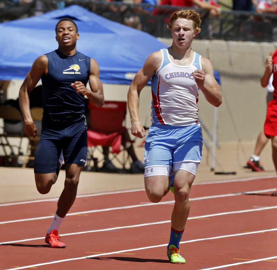 Photo - Austin Swann, right from Chisholm, wins and Heritage Hall's Dominique James is second in the Boys 3A 400 meter during the Class 3A-4A state track meet at Moore Stadium on Saturday, May 10, 2014 in Moore, Okla.  Photo by Steve Sisney, The Oklahoman