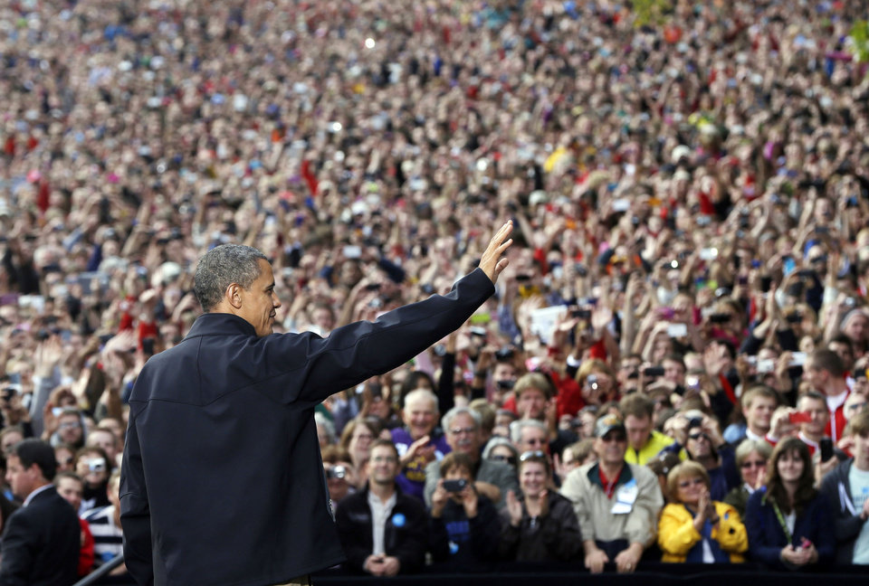 President Barack Obama waves to supporters as he takes the stage during a campaign event at the University of Wisconsin-Madison, Thursday, Oct. 4, 2012, in Madison, Wis. (AP Photo/Pablo Martinez Monsivais)