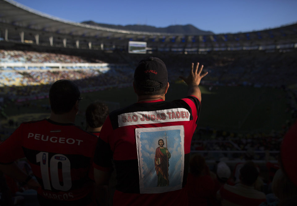 Photo - In this April 6, 2014 photo, a fan of the Flamengo soccer team wears a jersey decorated with an image of the Catholic Saint Judas Tadeu at the first match of the Rio championship at Maracana stadium in Rio de Janeiro, Brazil. Brazil's national team is seeking a record sixth World Cup title at this year's World Cup. (AP Photo/Leo Correa)
