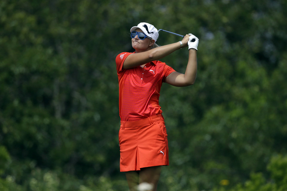 Photo - Anna Nordqvist, of Sweden, tees off on the 12th hole during the first round at the U.S. Women's Open golf tournament at Sebonack Golf Club in Southampton, N.Y., Thursday, June 27, 2013.   (AP Photo/Seth Wenig)