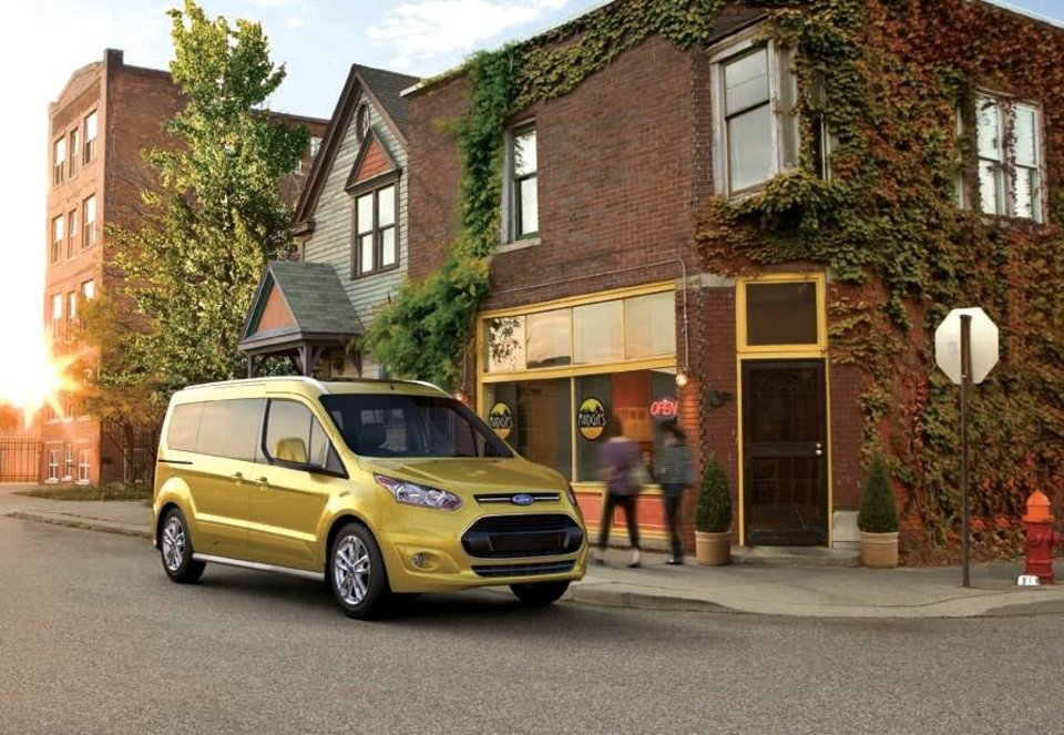 HOLD FOR RELEASE UNTIL 12:01 A.M. TUESDAY, NOVEMBER 13, 2012 - This undated image provided by Ford shows the Transit Connect Wagon. To the average buyer, or, in fact, to everyone outside of Ford Motor Co., the Transit Connect Wagon is Ford\'s first minivan after a six-year hiatus, but the Transit Connect Wagon, which is based on Ford\'s Transit Connect commercial van, has the high roof of the van but trades its industrial-looking hood for the tapered nose and trapezoid grille of Ford\'s cars. (AP Photo/Ford, Steve Petrovich) ORG XMIT: NYBZ119