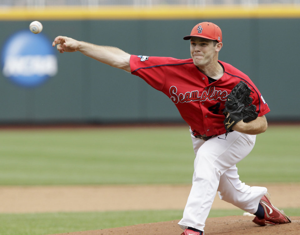 Photo -   Stony Brook's starting pitcher Tyler Johnson delivers against UCLA in the first inning of an NCAA College World Series baseball game in Omaha, Neb., Friday, June 15, 2012. (AP Photo/Nati Harnik)