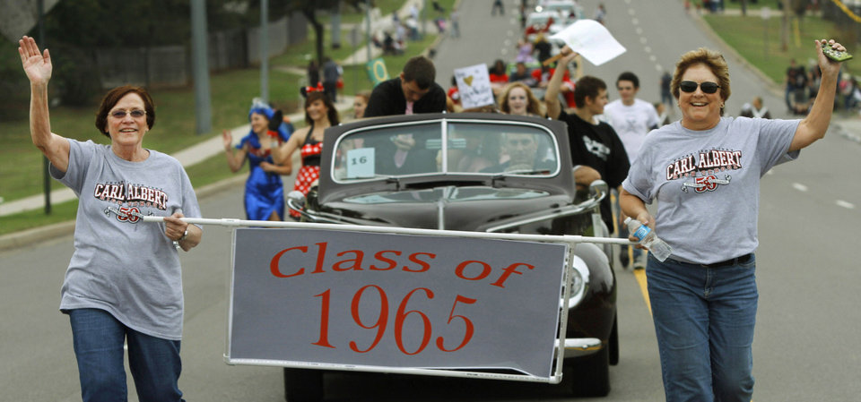 Representatives of Carl Albert's class of 1965 march in the Carl Albert High School homecoming parade. Photo Jim Beckel, THE OKLAHOMAN